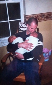 The youngest two, Joseph and Joshua, in the arms of their Dad.